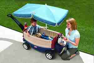 baby-enjoy-the-riding-with-Little-Tikes-Deluxe-Ride-and-Relax-Wagon